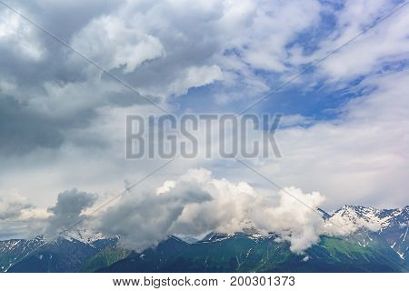 Beautiful Cloudy Sky Above The Peaks Of The Caucasus Mountains