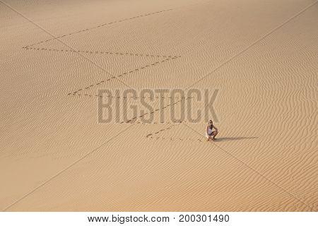 woman in  a desert landscape of Rub Al Khali