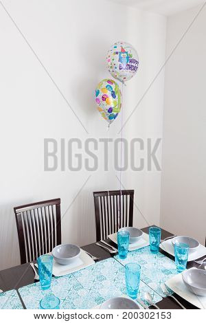 Poor decorated birthday big table with balloons.