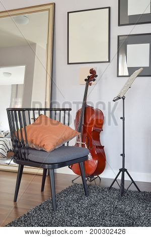 Cello Or Violoncello Musical Instrument With Wooden Chair And Pi