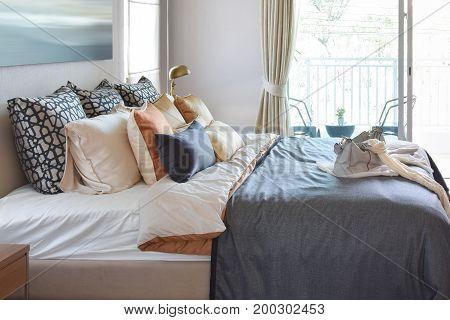 Modern Bedroom Interior With Vintage Handbag On The Bed