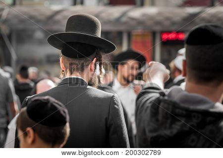 The Jewish Hasid in traditional clothes with long payos.