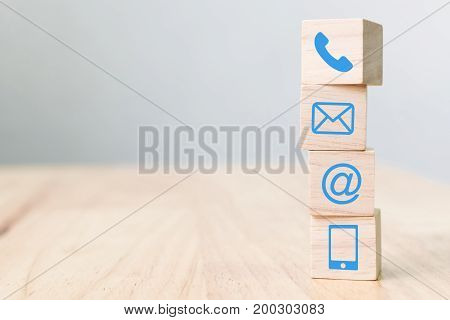Wood block symbol telephone mail address and mobile phone Website page contact us concept