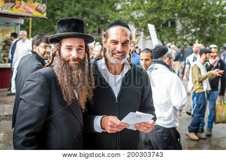 Uman Ukraine - 2 October 2016: Rosh Hashanah Jewish New Year 5777. It is celebrated at the grave of Rabbi Nachman. Pilgrims of Hasidim in traditional festive attire celebrate mass on the Uman.