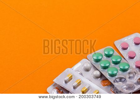 blister of Pills on the orange background