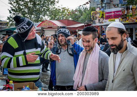 Uman Ukraine - 2 October 2016: Rosh Hashanah Jewish New Year 5777. Pilgrims of Hasidim in traditional festive attire celebrate mass on the Uman. Sellers of souvenirs.