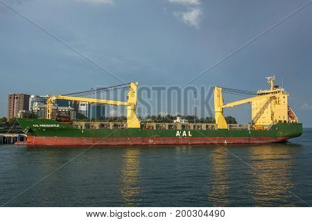Labuan,Malaysia-July 23,2017:Cargo ship,full of shipping containers in the port of Labuan island,Malaysia.