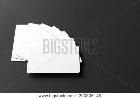 Empty white business cards on dark background. Namecard concept. Mock up 3D Rendering