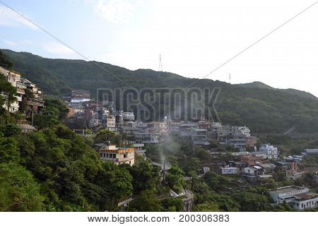 Jiu Fen In Taiwan. A Tourist Area With A View Of The Houses And Buildings Standing On Top Of Each Ot