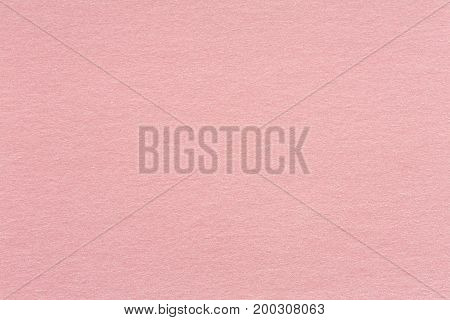 Recycled craft paper textured background in light pink old rose color tone: Detailed texture of recycled kraft paper fiber in pastel toned style. High quality texture in extremely high resolution