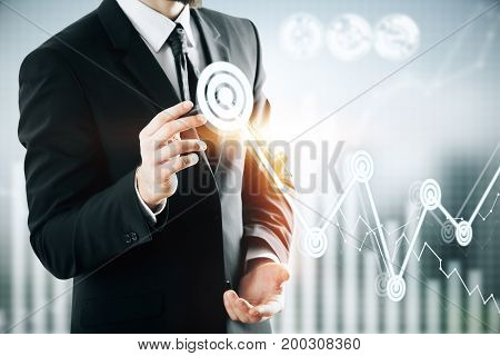 Businessman drawing abstract business chart on blurry background. Finance and targeting concept. Double exposure