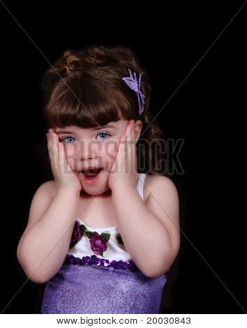 Adorable Young Ballerina With Hands On Cheeks.isolated