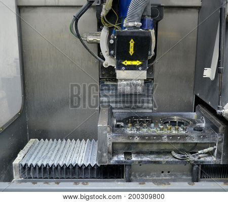 Milling machine. Milling machine that mills titanium Dental implants. Overall plan