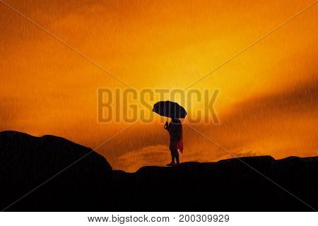 Young girl asian stand with raincoat and umbrella on mountain in the rainy season silhouette