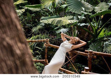 Beautiful Woman In Tropical Orangery