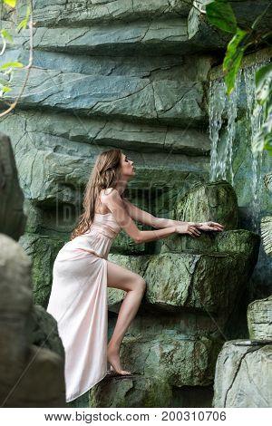 Beautiful Woman Near Waterfoll
