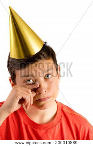 Young teenage boy isolated on white crying at a party