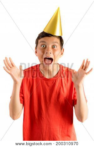 Young teenage boy isolated on white looking surprised at a party