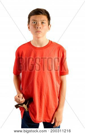 Young teenage boy isolated against white removing a cruxifix from his pocket
