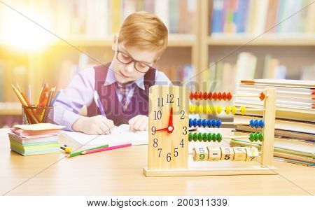 Student Child in School Kid Boy Writing Mathematics in Classroom Elementary Education