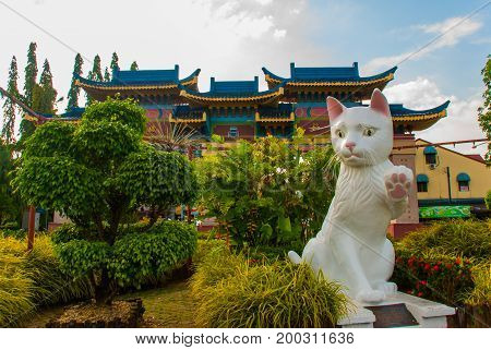 White Cat Monument Is The Kuching South City Council Cat Statue. Sarawak Malaysia.