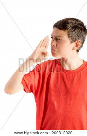 Young teenage boy isolated on a white background wafting a smell away