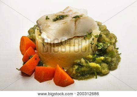fine dinning steamed cod with mashed potato carrots and mushy pea
