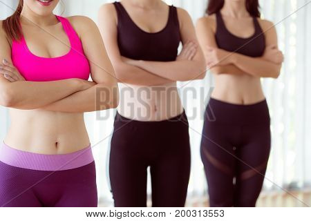 Sporty Women Team In Fitness Gym
