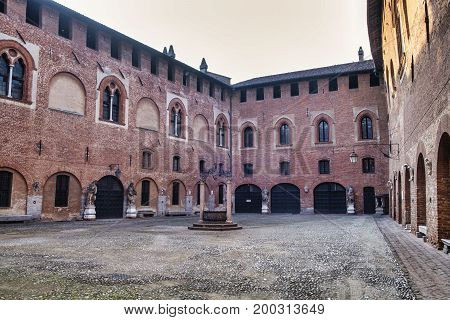 SANT'ANGELO LODIGIANO, ITALY - JUNE 24, 2017: Sant'Angelo Lodigiano (Lodi Lombardy Italy): the medieval castle the courtyard