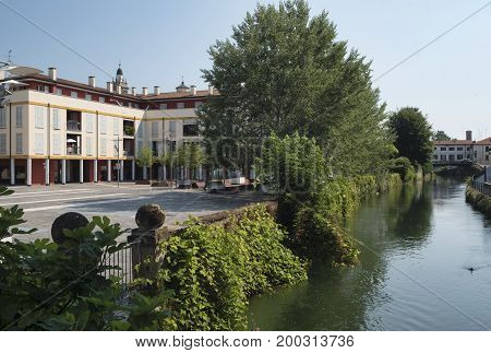 Gorgonzola (Milan Lombardy Italy): the canal of Martesana and a town square known as Piazza della Repubblica
