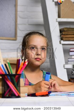 Kid And School Supplies On Classroom Background
