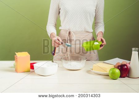 House Wife Wearing Apron Making. Steps Of Making Cooking Apple Cake. Cutting Green Apple.