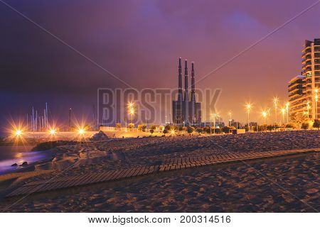 Sunrise in Barcelona beach in Badalona on the petroleum bridge