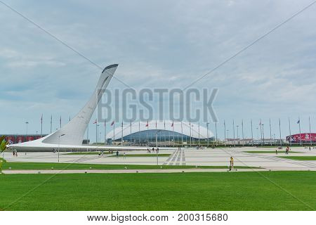 Sculpture-torch At Medals Plaza, Olympic Medalists Of The Winter Olympics In Sochi. Cloudy Summer Ev