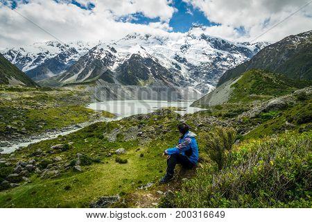 Mountain Hiker Traveling In Wilderness Landscape.