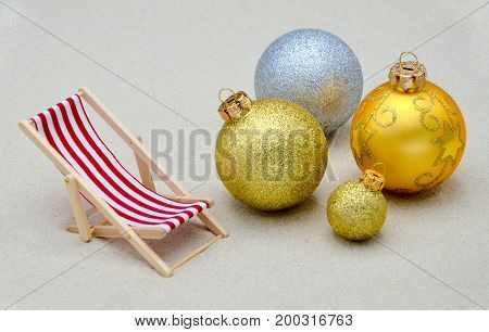deck chair with christmas balls close up photo