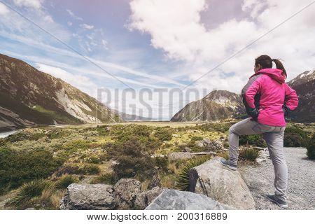 Woman Traveller Traveling In Wilderness Landscape