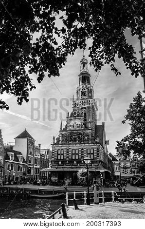 ALKMAAR THE NETHERLANDS - AUGUST 25 2013: Urban landscape in Alkmaar the Netherlands with the Weigh House in the background black and white image