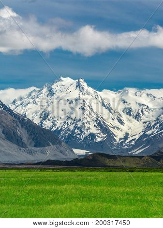 Mountain Ranges And Green Grass Field Landscape