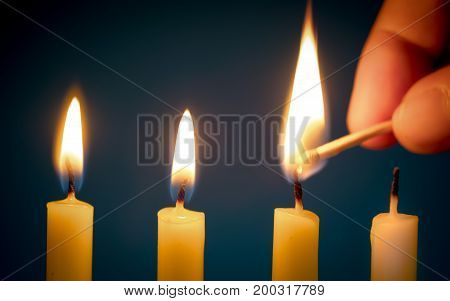 Hand Holding A Matchsticks, Going To Burn A Candle For Begin Of Life. Concept Of Forward Candlelight