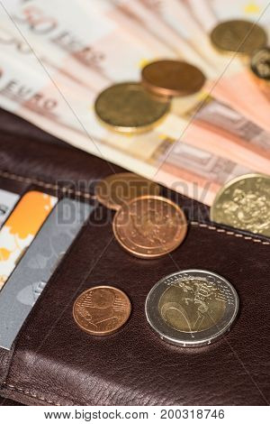 Wallet with credit cards and money. Fifty euros and cents