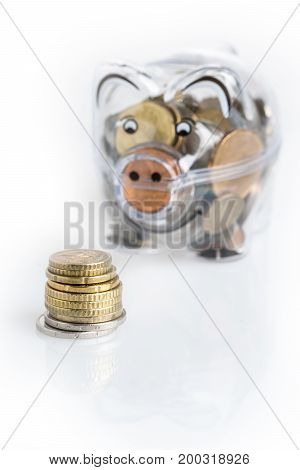 Piggy bank euro coins. Money saving concept. Banknotes closeup isolated white background.
