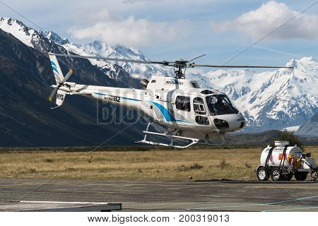 Helicopter Flys In The Mountain Area