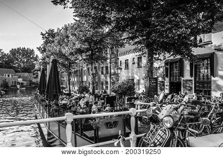 ALKMAAR THE NETHERLANDS - AUGUST 25 2013: People sitting at a restaurant terrace enjoying a warm summer day in Alkmaar the Netherlands