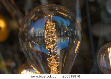 Close up glowing vintage light bulb store