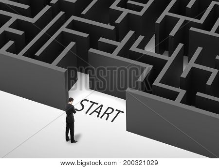 Thoughtful businessman standing in front of gray maze. Labyrinth concept. 3D Rendering