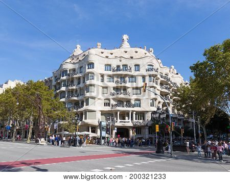 Barcelona - October 10 2015: Residential building of architect Antoni Gaudi - Casa Mila and many tourists October 10 2015 Barcelona Spain