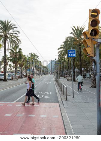 Barcelona - October 10 2015: People cross the road at the pedestrian crossing on Columbus Avenue October 10 2015 Barcelona Spain