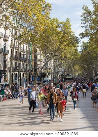Barcelona - October 10 2015: Happy people are walking on the Rambla street in Barcelona October 10 2015 Barcelona Spain