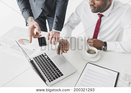 Multiethnic Businessmen Working On Laptop